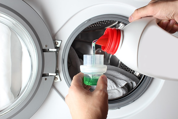 difference between regular laundry detergent and high efficiency
